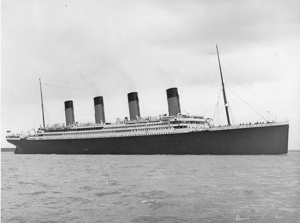 Titanic taken from the Isle of Wight by Beken of Cowes. Crowds are still lining the decks as she proceeds on her way.