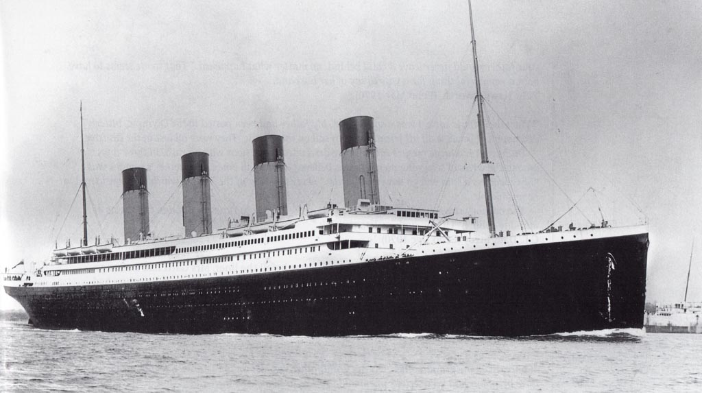 Titanic in Southampton Water. Crowds line her decks as the voyage begins.