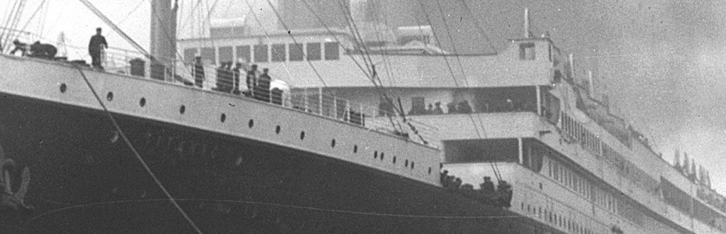 Close up of Titanic's bow with people on board