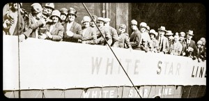 Old image of lots of people boarding a White Star ship