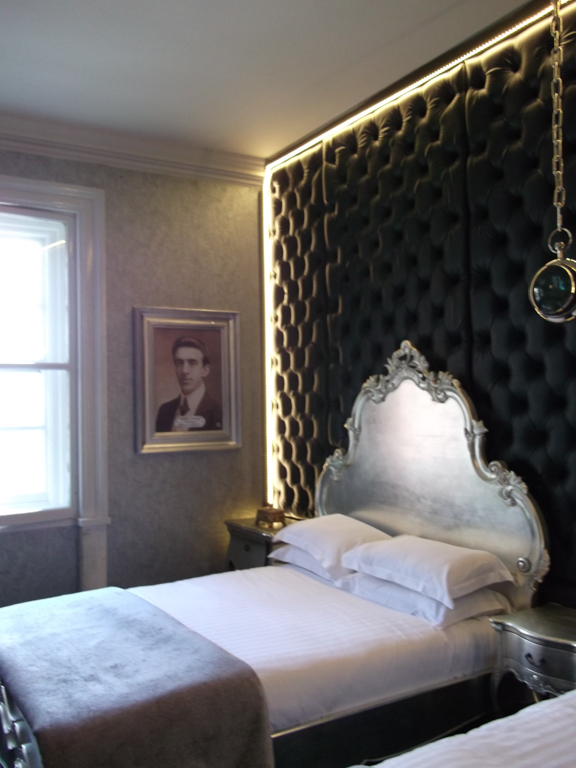 Hotel bedroom with picture of Wallace Hartley