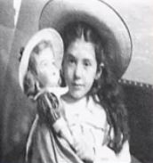 Black and white photograph of Eva Hart as a little girl holding a doll