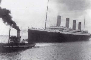 Titanic being pulled by a tug as leaves Southampton