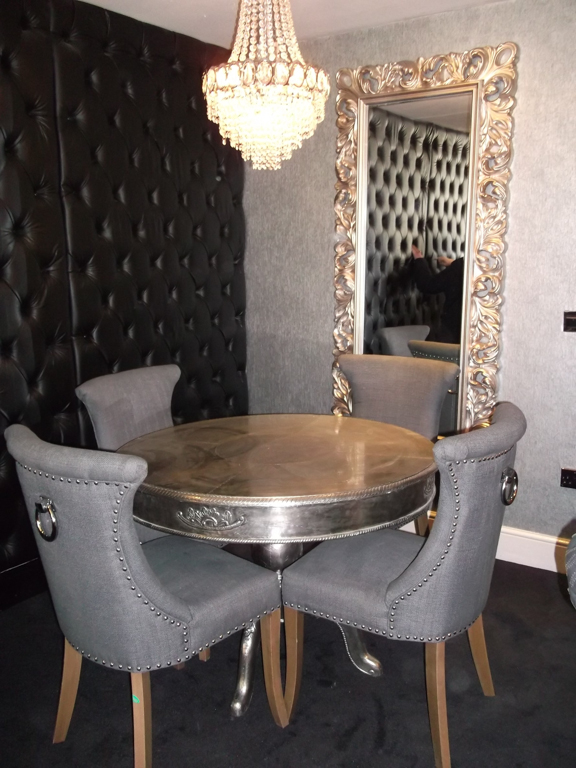 Interior of hotel room - silver table and grey chairs