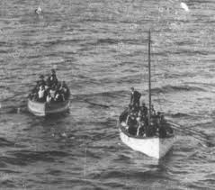 Lifeboat with mast in place, towing collapsible D approaching the Carpathia