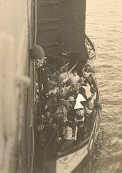 One of Titanic's lifeboats alonside the Carpathia, about to unload passengers. Taken from Carpathia's deck
