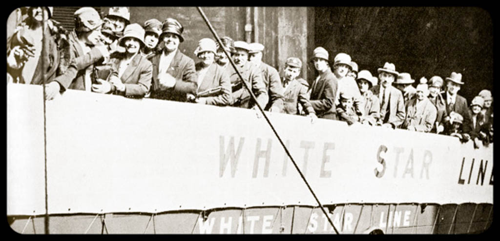 Old picture of lots of people boarding a white star line ship