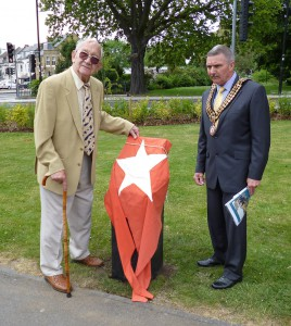 Bruno Normandis about to unveil the memorial which is still covered with a White Star Line flag