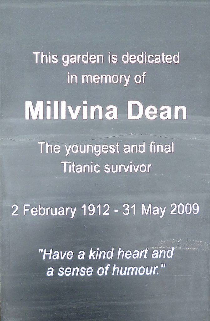 The memorial reads: This garden is dedicated in memory of Millvina Dean, the younget and final Titanic survivor. 2 February 1912 - 31 May 2009