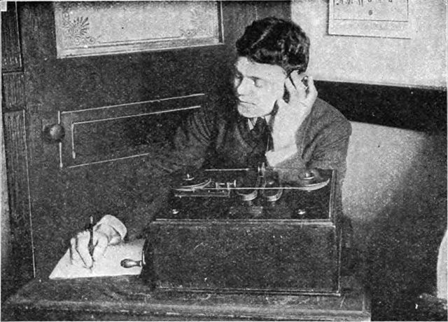 Black & white image of a man using early marconi wireless equipment